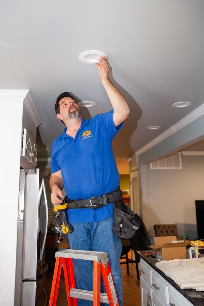 Hot Shot Electric working on recessed lighting