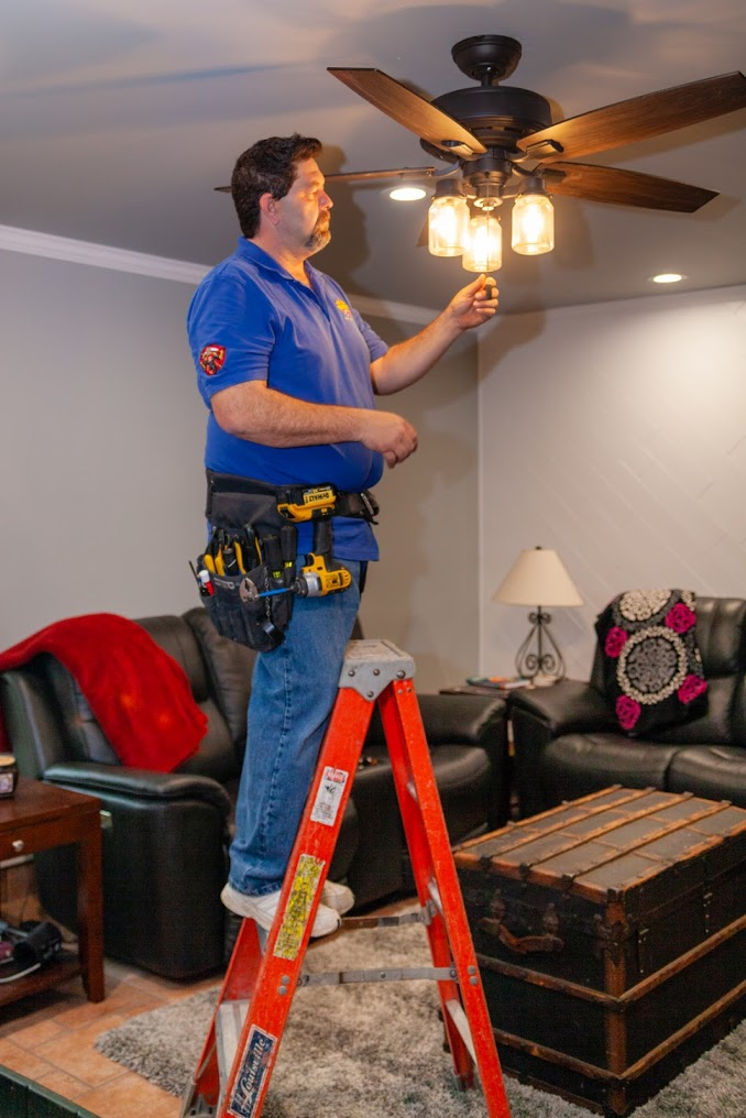 Hot Shot Electric working on ceiling fan
