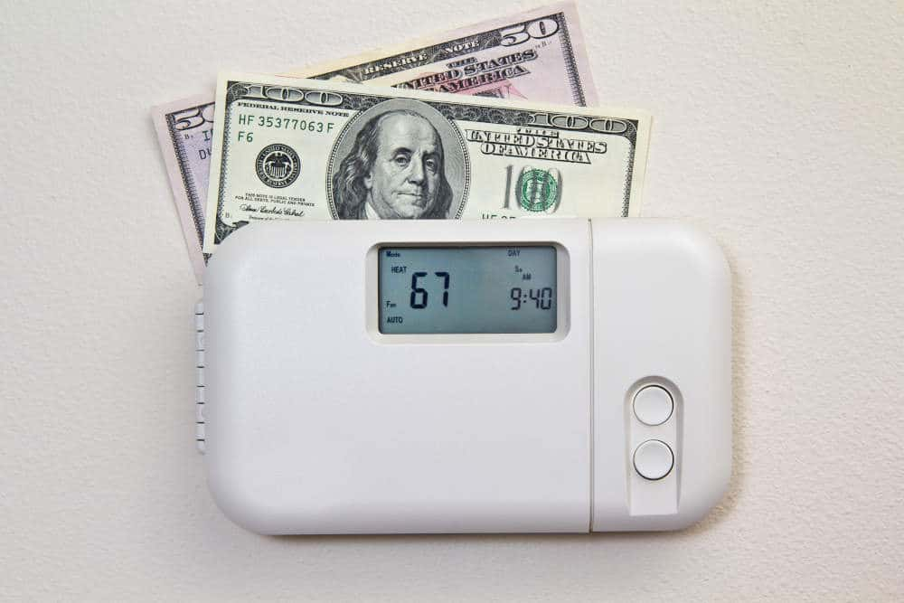 close up of thermostat with money on top