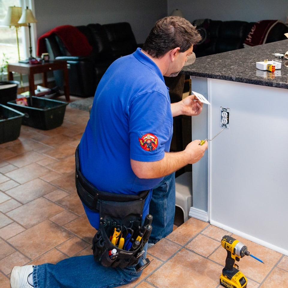 Hot Shot Electric Working on Receptacle